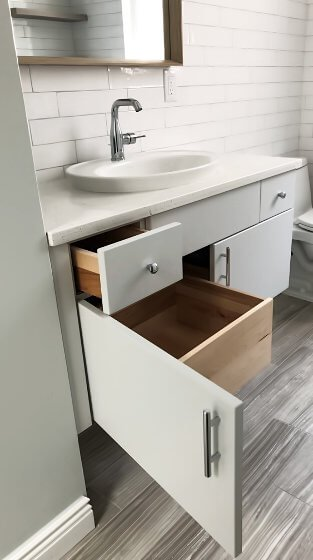 A small but efficient wall hung vanity will provide maximum storage and reveal more floor in your small bathroom
