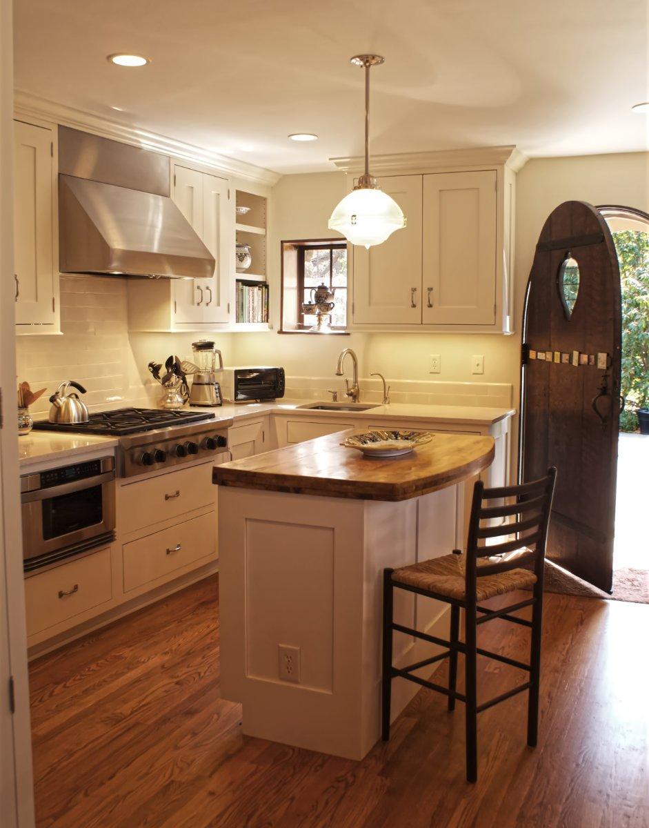 Remodeled Tudor kitchen with Viking range and open shelves for cookbooks