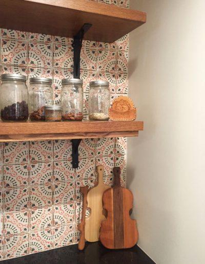 Open Wood Shelving for Spices with Art Tile Backsplash