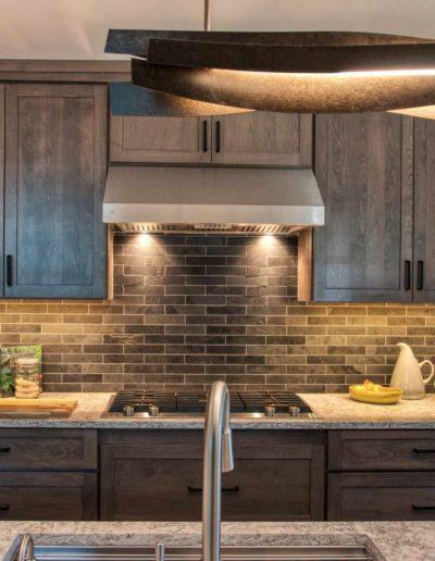 Sculptural Island lighting and brick pattern backsplash tile - McManus Group Inc - Westchester NY