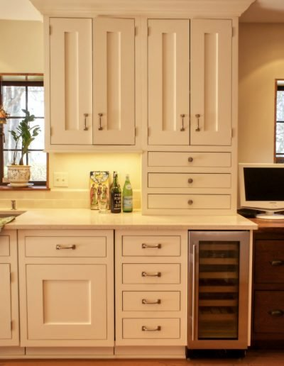 Creme Painted Kitchen Cabinets with Under Counter Wine Refrigerator