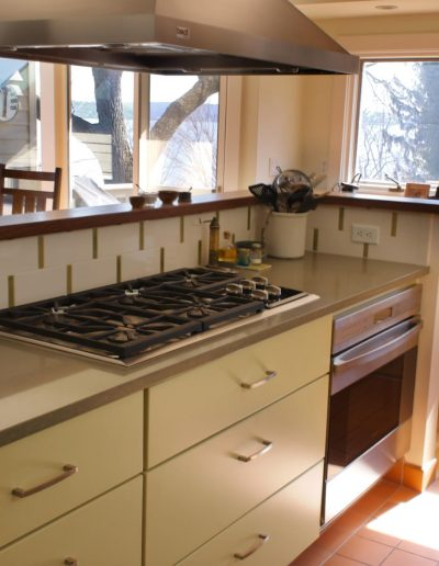 Modern Open Plan Small Kitchen with Pratt & Larson Tiles, Undercounter Oven and Painted Cabinets
