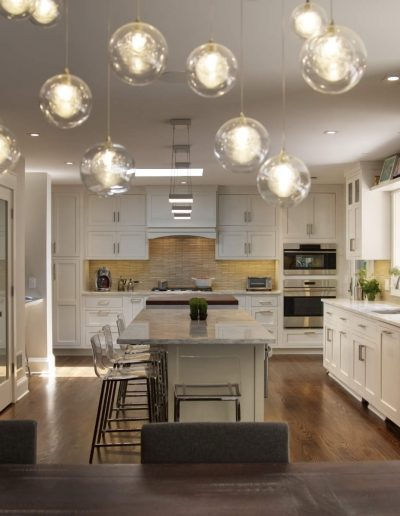 White Kitchen with Dining Room Table by McManus Group, Nyack