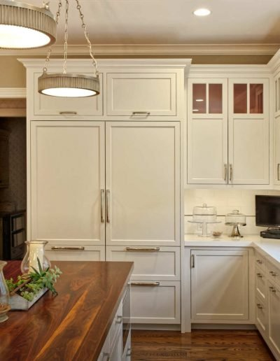 Sub Zero Freezer and Refrigerator built ins and Island with reclaimed Mahogany Top with Satin Nickel Pendant Lighting.
