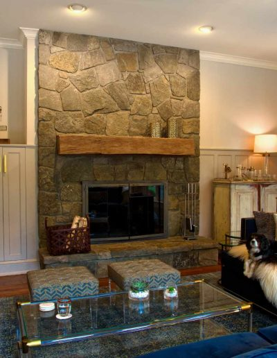 Living room with rustic fireplace