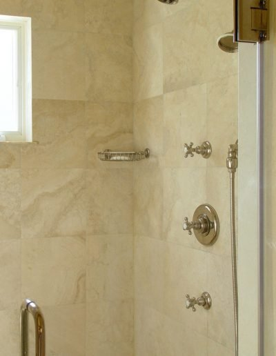 Shower with Glass Door with Marble walls and Fixtures by Waterworks