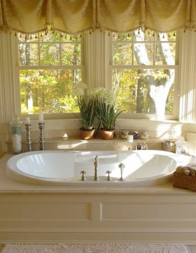 Master Suite Two Person Air Bath with Luxury Marble Floor and Paneled Surround.