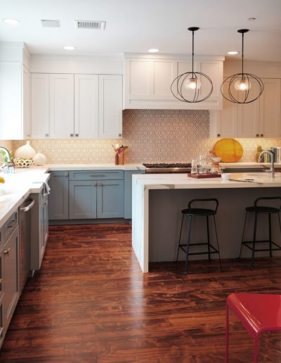 Kitchen with Simple Palette is Calming Complemented by Art Tiles & Handmade Accents