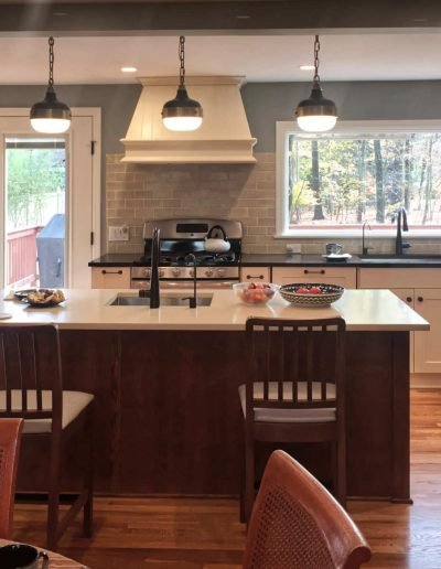 Open Plan for Two Cook Rustic Kitchen with traditional pendant lighting over island