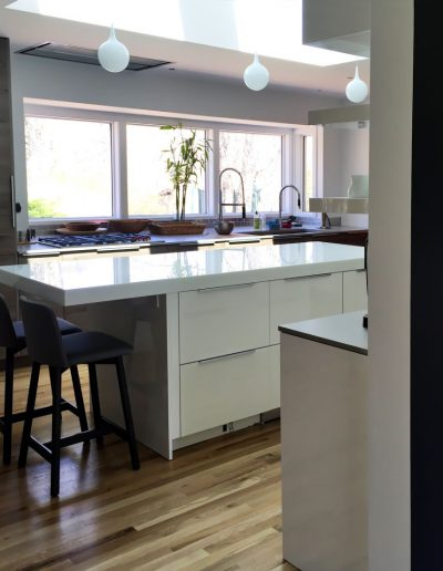 Uber modern kitchen in Nyack with island countertop of thick glass