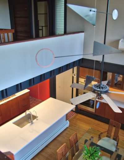 Modern kitchen viewed from mezanine with Alexander Calder inspired mobile